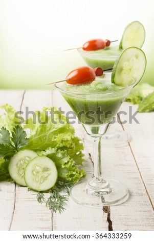 Green diet smoothie with vegetables on wooden table, diet background