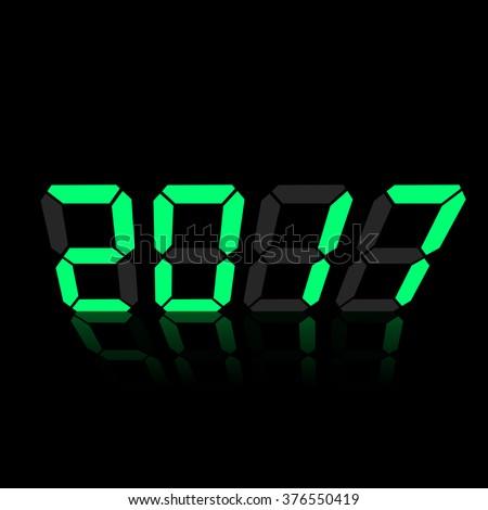 Green digital numbers 2017 year time on a black background.