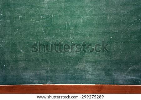 Green dirty chalkboard background - stock photo