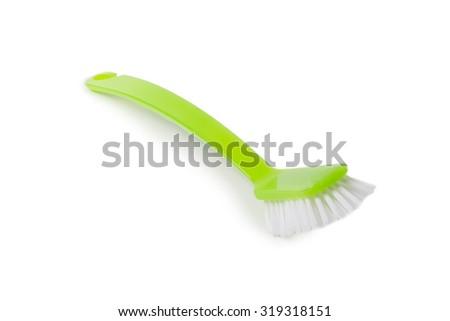 Green dish washing brush isolated on white background - stock photo