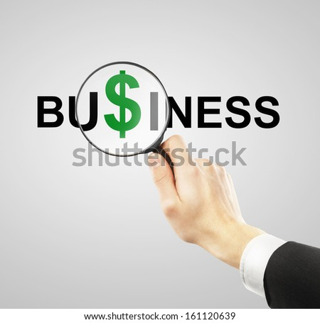 green dolar symbol in big magnifier - stock photo