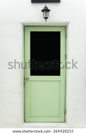 Green door isolated on White wall