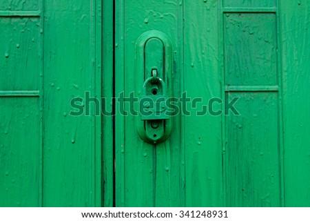 Green door with lock - stock photo