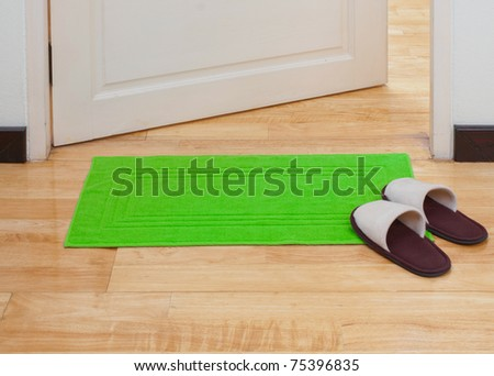 Green doormat help you clean your feet before come in home - stock photo