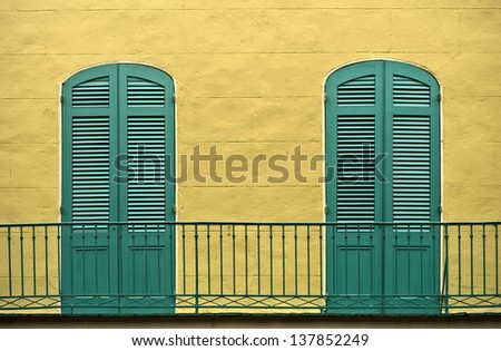Green doors in the French Quater - stock photo