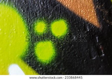 Green dots graffiti macro - stock photo