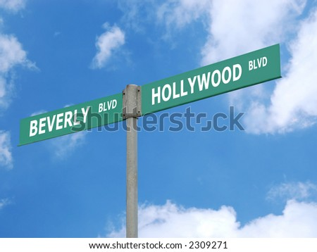 Green double signpost indicating Hollywood and Beverly boulevard directions over blue sky