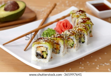 Green dragon sushi roll with eel, avocado, cucumber, wasabi and ginger. - stock photo