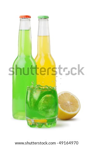 Green drink in a glass and a bottle