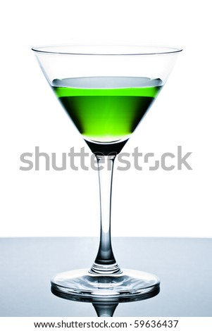 Green drinks in martini glass on white background with reflection