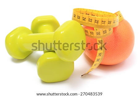 Green dumbbells for using in fitness, fresh grapefruit and tape measure, concept for slimming, healthy nutrition and lifestyle. Isolated on white background - stock photo