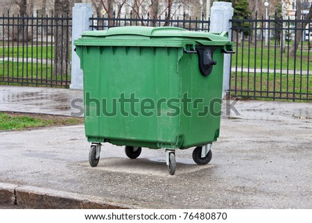 Green dumpster - stock photo