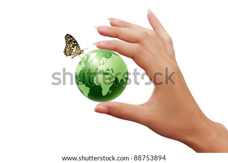 green earth globe in woman hands and butterfly