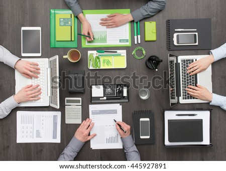 Green eco-friendly and creative workspace opposing to standard monochromatic people and objects, individuality and business leadership concept - stock photo