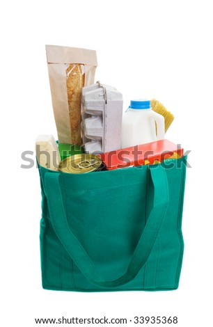 Green eco friendly grocery bag full of food - stock photo