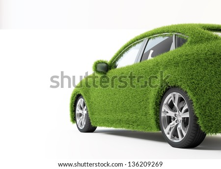 Green, ecofriendly transport concept - grass covered car. - stock photo
