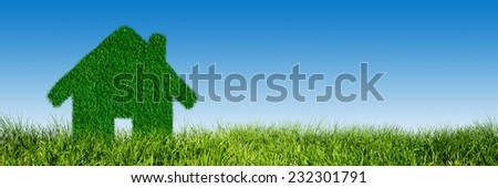 Green, ecological house, real estate concept. Grass land, blue sky. Clean energy, environment - stock photo