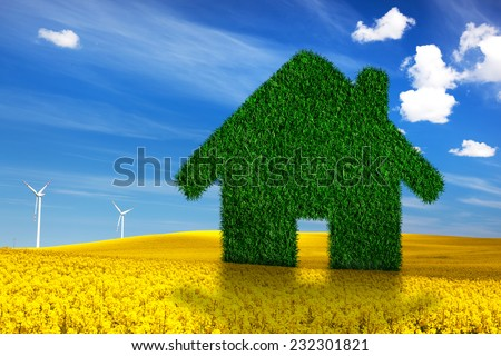 Green, ecological house, real estate concept. Spring land, blue sky, wind turbines. Clean energy, environment - stock photo