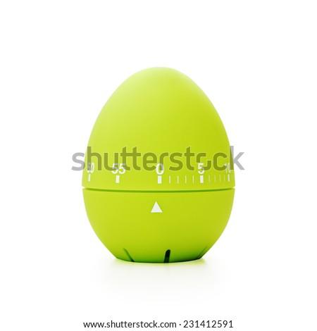 Green egg-shaped timer stopped at zero. Isolated on white background. - stock photo