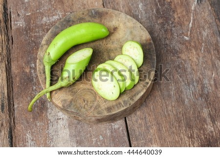 green eggplant  fresh vegetable  on a wooden table  background - stock photo