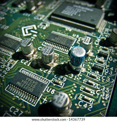 Green electronic circuit close-up. Macro background