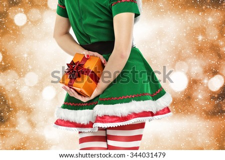 green elf with box and golden space of lights  - stock photo