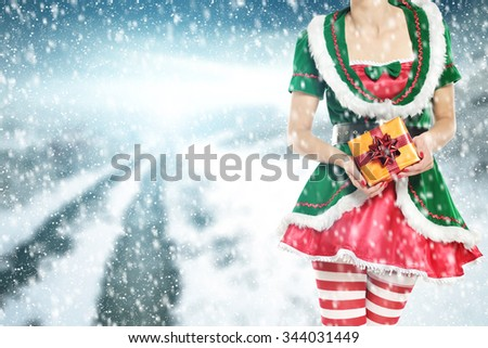 green elf woman box and sun of winter time  - stock photo