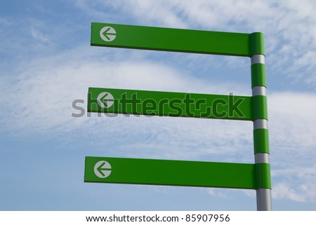 Green Empty Directional Arrow Sign with Blue Sky - stock photo