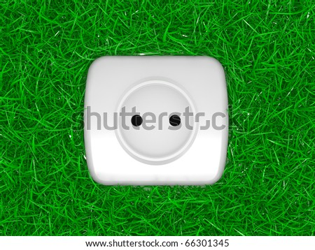 green energy concept, outlet on a grass - stock photo