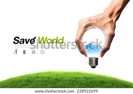 Green energy concept - water in bulb and grass field with bulb shaped hand, clipping path - stock photo