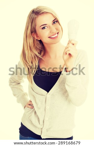 Green energy concept. Woman with led light bulb - stock photo