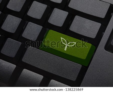 Green energy key with leaf icon on keyboard - stock photo