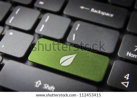 Green energy key with leaf icon on laptop keyboard. Included clipping path, so you can easily edit it. - stock photo