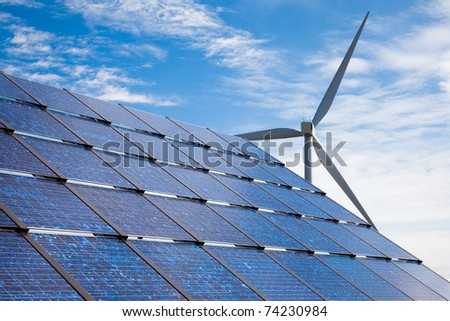 Green energy - solar panels and wind turbine. - stock photo