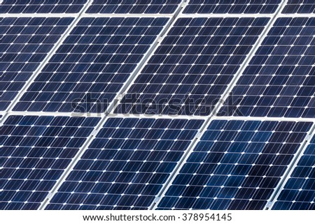 Green energy solar panels on the roof of a house facing the sun making electricity / Green energy solar panels on the roof of a house - stock photo