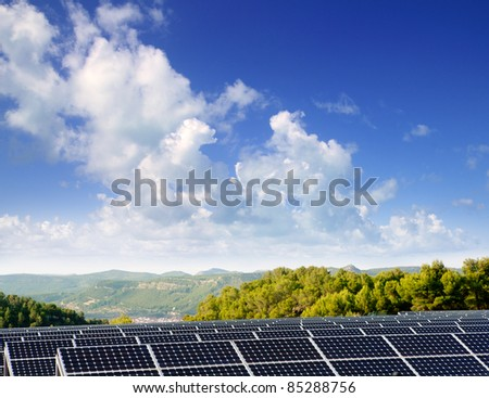 green energy solar plates to provide mountain valley village - stock photo