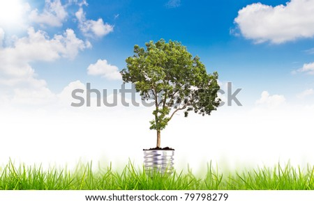 Green energy symbol over blue sky - stock photo