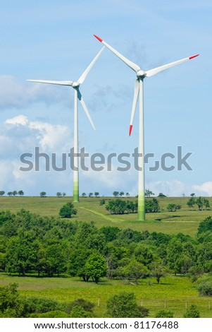 Green energy windmill generators ecology countryside blue sky - stock photo