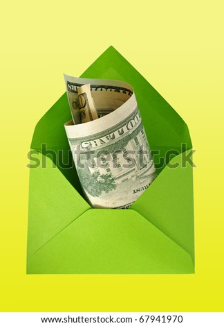 Green envelope with dollars isolated on the yellow surface with work paths. - stock photo