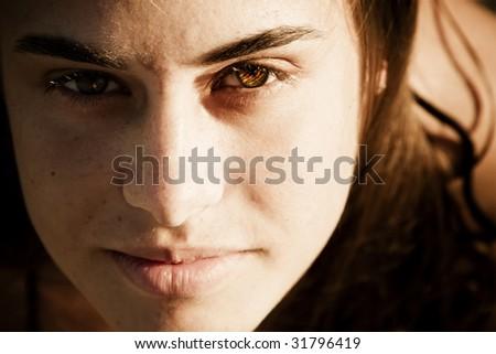 Green eyed beauty staring at camera. - stock photo