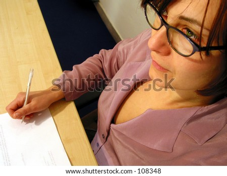 green eyes business woman or a secretary signing a contract