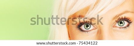 Green eyes on green background (banner) - stock photo