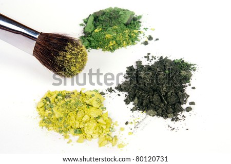 Green eyeshadow palette with brush on white background - stock photo