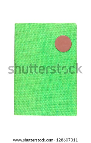 green fabric cover note book on white background