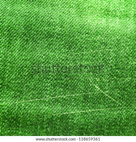 Green fabric with lines as a background or texture