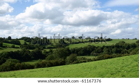 Green Farmland and Blue Sky with Cloud - stock photo