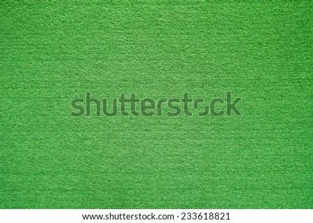 Green felt background. - stock photo