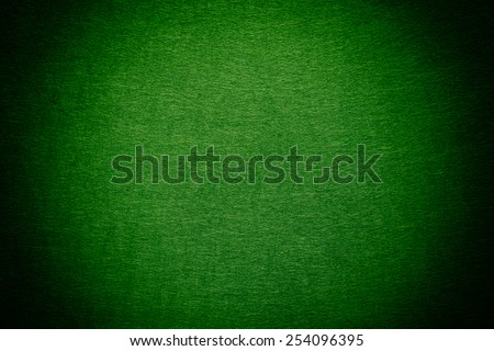 Green felt background. Vignette. - stock photo