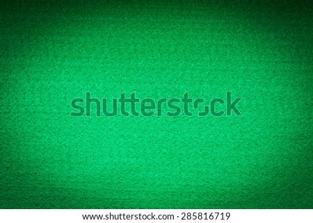 Green felt background with vignette. - stock photo