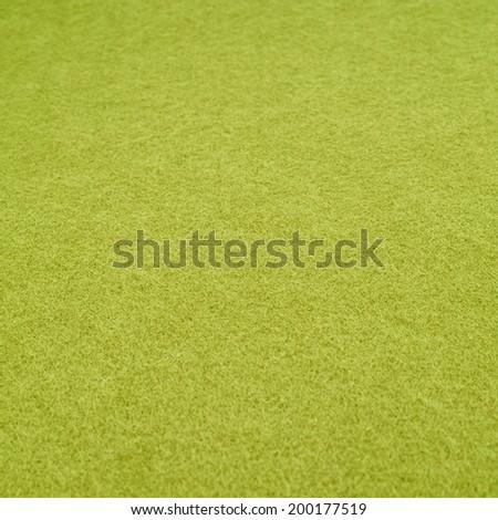 Green felt cloth fragment, shallow depth of field composition - stock photo